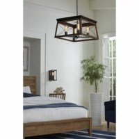 Create a cozy and comfortable home atmosphere with the classic barn-like touch of the  Four-Light Rustic Linear Chandelier. A farmhouse-inspired X-brace design stretches across each side of the frame recalling old barn doors and rustic farmhouse gates. From inside the enclosure peeks metal light bases waiting to hold light sources as they exude a comforting country glow. A graphite plate accents the top of the structure as thin metal bars anchor the rustic light fixture to the ceiling. The...