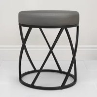The vanity seat is a luxurious addition for your home. This stool features a comfortable, grey faux-leather upholstered foam seat and a sculptural frame in a modern, matte black powder-coated finish. It is fully assembled, easily place this seat in your bathroom, at your vanity or anywhere else within your home.