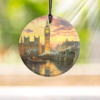 Big ben towers over the house of parliament. As the sun sets, reflecting across the river Thames, one of London's world-famous double-decker buses crosses Westminster bridge. This light-catching Starfire prints hanging glass, featuring Thomas Kinkade's London, brings the historic, vibrant city to life in your home. It comes with a hanging string for easy display. Starfire prints hanging glass are photographic quality prints on translucent glass. It is featuring artwork from your favorite...