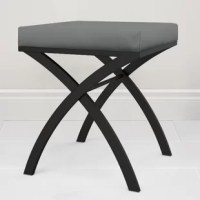 The vanity seat is a luxurious addition for your home. This stool features a comfortable, grey faux-leather upholstered foam seat and an architectural frame in a modern, matte black powder-coated finish. It is fully assembled, easily place this seat in your bathroom, at your vanity or anywhere else within your home.
