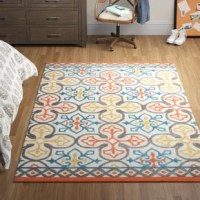 A classic quatrefoil pattern gets an eye-catching update with this striking area rug, showcasing a mix of geometric motifs in gray, yellow, orange, and blue hues up against a neutral background. Hand-tufted in India from 100% wool with a medium 0.4