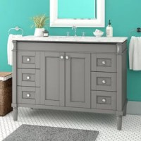 Lend an eye-catching focal point to your bathroom base while increasing storage space with this stylish vanity set. Crafted from solid oak wood with laminated veneer panels, the base boasts a neutral finish for a look that complements nearly any color palette and includes six drawers for keeping tabs on washroom essentials. Up top, the stone countertop boasts a carrara white finish and includes an integrated sink with three holes for pairing with a fitting faucet of your choice.