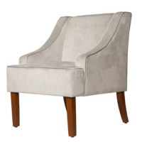 A contemporary update on a classic design, this charming swoop armchair lends a touch of tailored appeal to your seating ensemble. Made with a solid hardwood frame and iron hardware, this lovely design is draped in velvet upholstery with foam cushioning and handsome piping, and showcases swooping recessed arms and four tapered square legs.