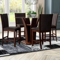Whether it be a birthday party, a reunion dinner with old friends, or simply serving up weeknight family meals, you'll be celebrating in style at this product. Sitting at the center of it all is a distinctive pedestal table, founded atop an openwork wood base finished in dark cappuccino while a contrasting clear glass top adds a hint of elegance. Grouped around in gorgeous style is four high style stools, featuring curved full-back seats wrapped in glossy leather-inspired upholstery in a solid...