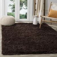 Lay a textured foundation for your stylish space with this chocolate shag area rug. Made in China, this area rug is hand-tufted from stain- and fade-resistant acrylic in a thick 1