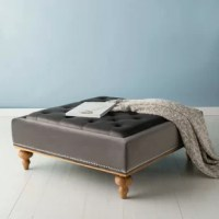Makes a grand design statement with this elegant contemporary tufted ottoman. Rich and luxurious, it features a slightly raised layer of tufting that highlights its sophisticated, generous velvet upholstery. Chic, sculpted oak wood legs make it timeless.