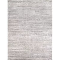 Set a modern foundation for your stylish space with this distressed area rug, showcasing an abstract motif in hues of sleek gray and brown