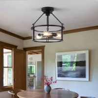 This semi-flush mount features an antique black finish with a light brush of bronze that lends a rustic vibe. The clear glass shades will allow the light to shine throughout your room unimpeded.