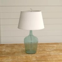 Conanso 27'' Table Lamp makes an elegant addition to your living space. This unique lamp features a luxuriously designed glass base with a beautiful shade to give your home that stylish and elegant accent. Display it on a side table and its fine details will accentuate and complement your home decor.