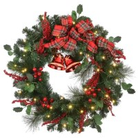 This holiday wreath features thick evergreen branch tips trimmed with holly leaves, berry clusters, and pinecones. At the top center, a red plaid ribbon and bow with bell decorations beneath. It is pre-lit with 50 warm white battery operated LED lights for added sparkle. Display this wreath on doors, walls, and windows in indoor or covered outdoor locations.