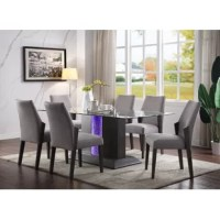 The Bender Dining Set combines the sharp modern look of tempered glass with the warmth of a gray oak finished base. A traditional height dining table that comfortably seats six, the collection adds upscale glamour bringing a chic, industrial feel to your dining area. It's elegant tempered glass top features asturdy base with LED lighted inlay. This dining set will be the focal point of any dining room.