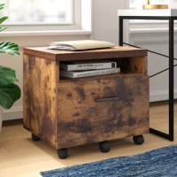 Lend an eye-catching focal point to your home office while bringing a touch of rustic appeal with this stylish filing cabinet. Crafted from manufactured wood with solid wood veneers, it showcases a weathered oak finish for a look that complements a variety of design aesthetics from rustic to contemporary. Rolling casters on the base allow for easy transport between rooms, while the shelf, drawer, and tabletop provide a space to store and stage loose odds and ends.