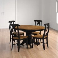 Anchor your dining space in traditional cottage style with this five-piece extendable dining table. Crafted of solid rubberwood in a handsome two-tone finish, the dining table strikes an oval-shaped silhouette with a smooth, molded edge. The chunky pedestal base includes lathed details and four cabriole legs, while a 15