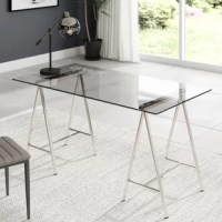 Have the world at your fingertips with this glass top home office desk. A sturdy tempered glass desk top printed with a world map in words and modern nickel legs for support.