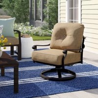 This rocking chair is the ideal addition to your porch or back patio. It's founded atop a weather-resistant powder-coated aluminum frame, with a swiveling rocker that makes it easy to relax, whether you're sipping your morning coffee, reading a book, or chatting with friends. Polyester blend cushions add an inviting look and showcase a neutral beige hue. Measures 34.5'' H x 29.5'' W x 29'' D and arrives in a set of four.
