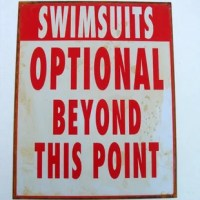 Swimsuits Optional Tin Sign Rustic Distressed Finish Plaque makes a great addition to your pool, tiki bar, jacuzzi, patio, backyard, or anywhere else you want people to know that it's OK to go nude! This new swim suits sign has a distressed antique finish to look like vintage signs of yesteryear. Sign measures 15