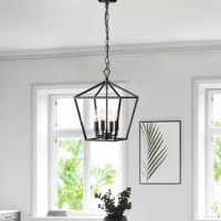 Brighten up your kitchen, entryway, or dining room with this 4-light geometric pendant. It hangs from a matte black chain, and has an adjustable hanging height, adjustable from 21'' to 57''. It showcases an open, geometric lantern shape, finished in a neutral black hue for a transitional look that blends in with a variety of color schemes. Inside, four candelabra-base bulbs of up to 60W (not included) illuminate your home, wherever you choose to hang it.