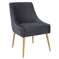 Sit pretty in this sumptuous yet durable velvet chair. The Dusek dazzles as a dining chair or as an accent piece. Fab stainless steel legs and a matching handle on the back. Prop it into any room for a luxe, glamour effect.