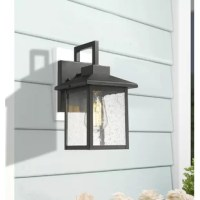 This 1-light armed sconce adds a boost of brightness to your living room, bedroom, or entryway! Showcasing an updated lantern look, this metal design features a square backplate, geometric arm, and molded roof, all finished in a neutral black hue. Its rectangular shade features clear, seeded glass panels that reveal a single bulb (not included). The bulb is easy to install through its open base. Plus, this outdoor sconce is weather-resistant, so you can mount it in uncovered outdoor areas.