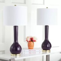 A mid-century modern design gets a contemporary update with this standard. Made from ceramic with a glossy finish, it showcases a slender and abstract gourd-shaped silhouette that grabs glances in any arrangement. A shiny metallic-finished metal base down below offers a touch of glamour, while an understated white cotton drum shade up above balances out the look. Plus, it arrives in a set of two. This design accommodates medium-base bulbs of 7 W maximum for incandescent or LED and 13 W for...