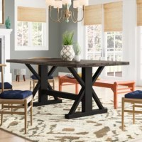 An anchor piece in your home, your dining table is central for your home's style, and also the spot where friends and family will gather for a meal, so it should deliver an on-trend look and seating space perfect for your needs. This table, for example, is a great option for lending your ensemble a versatile look at home in styles from rustic-inspired to eclectic thanks to it's trestle style base.