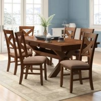 Whether hosting a dinner party with close friends or enjoying an everyday meal with the family, this seven-piece dining set is a must-have for your home. Anchoring your dining room with a touch of traditional style, this set features six chairs with open backs and a clean-lined table founded atop an x-shaped trestle base. Plus, its butterfly leaf mechanism allows you to extend the length to accommodate two additional diners.