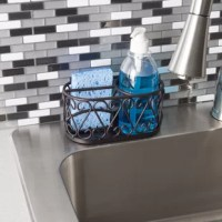 Lay this soap dispenser with caddy in the corner of your bathroom vanity to lend a modern elegant flair. Intricate scroll detailing, along with a rich bronze finish adorns the structure to set a sophisticated backdrop and a classic elegant for the included refillable soap dispenser. Compact and completely open, it smoothly drains out soap suds and excess water. Display in the bathroom, kitchen, to impart grace and beauty to your humble abode.