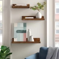 Increase storage space in any room without taking up valuable floor space using this eye-catching floating shelf set. Crafted from solid wood, each piece strikes a clean-lined silhouette and boasts natural wood grain knots for a look that combines modern aesthetics with rustic accents. Plus, each features nailhead details for a touch of industrial appeal. Best of all, it arrives with installation hardware so it's ready to go right out of the box.