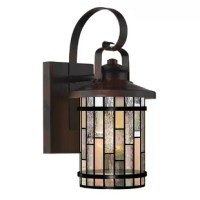 Traditional and contemporary elements combine to create a timeless look with the stylish design of this lamp. An eye-catching complement to any home that will easily blend with your home decor scheme. Featuring hand-crafted stained glass, any visitor will be amazed at the look and feel created by this piece as it brightens your home and your life, with beauty and elegance.