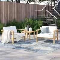Catch some sun poolside or invite that dear friend over for a coffee and catch-up with this three-piece set as a base! Crafted from solid teak wood, each piece showcases clean lines for a contemporary look, while natural wood grain accents lend a rustic touch. Foam filling in the polyester cushions bring added comfort to your porch or patio, while its neutral two-tone coloring easily blends with nearly any color palette. Plus, an included table keeps tabs on your drink while you soak in the sun.