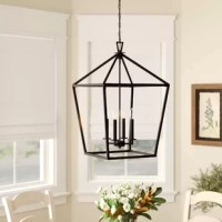 Don't let poor lighting ruin the ambiance of your ensemble! Sure to shine, this eye-catching lantern is crafted from metal, showcasing an openwork lantern silhouette that adds a dash of architectural appeal to the entryway, living room, or hall. Inside, a quartet of candle-style sockets holds aloft 60 W maximum bulbs (not included). This hardwired design is also compatible with a dimmer switch, so you can set the mood as you please.