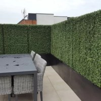 This Artificial Outdoor or Indoor Hedge looks so realistic and adds greenery to even the dullest surfaces. Durable UV-proof.  Comes with 24 20