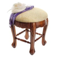 Rising from a hand-carved apron and cabriole legs to a perfectly cushioned seat, this Baroque-style solid hardwood stool is ideal bedside, in a luxury bath, or at a ladies vanity. Crowned with a generous expanse of tone-on-tone cream jacquard upholstery, this versatile, honey-hued work of European-style furniture art is as practical as it is elegant