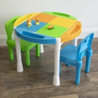 "Encourage creativity and imagination with the Humble Crew Kids 2-in-1  Activity Table with 100pc Starter Blocks and 2 Chair Set featuring a play surface compatible with building blocks. The 24"" round kids table set comes with 2 chairs, 4 removable storage bins and 100 building blocks. Tabletop easily converts to a construction table surface for use with most plastic building blocks, LEGO and Duplo products. The smooth table cover is ideal for snack time, coloring, arts and crafts, board games..."