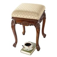 Rising from hand-carved Queen Anne legs to a cushioned seat, this sturdy, solid hardwood stool is perfect bedside, in a luxury bath or at a lady's vanity. Crowned with a generous expanse of quality, tone-on-tone jacquard upholstery. Simple assembly required.