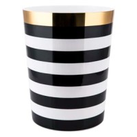 The eclectic mix of geometrics and stripes featured on each piece  will add drama and elegance to your modern bathroom setting. Each piece is offered in black and white and accented with a metallic gold band. The tumbler, toothbrush holder, soap dish, tumbler and cotton ball jar are made of ceramic. The matching wastebasket is made of plastic. Each piece is sold separately. Hand wash.