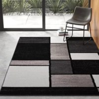Looks aside, these area rugs help absorb and decrease noise and soften the step of hardwood and tile flooring. With contrasting blocks of black, white, and grey, this rug adds a touch of drama to any interior design, while its half-inch pile stays shed-free with foot traffic. This product made in Turkey.