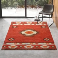 Bursting with Southwestern style, this eye-catching area rug instantly adds color and pattern to any ensemble. Low pile height for a look that's both classic and casual. Its traditional geometric motif stands out all on its own, but really pops thanks to bright hues of red wine and brown.