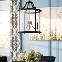 Furnish your space in bright style with this pendant light. Hanging from a round canopy and an adjustable chain is a metal birdcage-shaped frame in a neutral finish, with candelabra-style lights in the center. This pendant is surrounded by a cylindrical, clear glass shade that allows the light from four 60W bulbs (not included) to illuminate your space. You can install this light on a dimmer switch so you have the right amount of light no matter the time of day. Plus, it can be hung on a sloped...