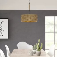 This series has a rope weaved frame from which light pierces through. A rope wrapped support rods and oil rubbed bronze finish complete this rustic look.