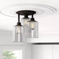 Sporting a simple and clean look, it would be great for an entranceway or main hallway, so it can be seen when walking into your home. This stylish and contemporary semi-flush mount is fashioned with a round metal backplate, and three-cylinder seeded glass shades at various lengths. It accommodates three A19 or ST19 medium-base bulbs, of up to 60 W each (bulbs not included). Hardwired in your home, this luminary is compatible dimmer kits, allowing you to set the mood when you set the level of...