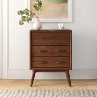 Looking to add a touch of extra storage to your ensemble, but can't sacrifice on style? Adding an accent cabinet like this is a great option for getting exactly what you need! Crafted from a blend of solid mango wood and manufactured wood, this clean-lined piece is founded on tapered legs for an on-trend mid-century look. A great option for rounding out a home office or living ensemble, this piece features three drawers perfect for tucking away clutter, this cabinet is ideal for additional...