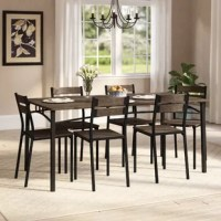 This Autberry 7 Piece Dining Set helps you create a simple and airy dining room. The table and side chairs are perfectly matched with smooth dark brown wood accents and slim metal supports. Arching metal accents accentuate the dining table's slim yet spacious design while durable metal construction ensures long-term strength.