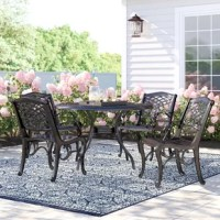 Take in the beauty of the great outdoors in a dining set that brings your next outdoor brunch or dinner party a luxurious atmosphere. Made from sleek cast aluminum, our dining set includes four chairs and one circular table of incredible durability and style. This set features an open metal weave motif with a beautiful scroll design that highlights its elegant hand-crafted details. Whether in your backyard, patio, or deck, this dining set will certainly set the scene for you and your friends to...