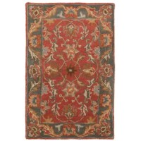 Sporting an intricate Persian-inspired design, this area rug makes an excellent focal point in your living room, dining room, or bedroom. It showcases muted burnt orange, dark brown, rust, and taupe colors for a traditional look that appeals to a wide variety of aesthetics. Handmade in India from premium quality wool, it's tufted for optimum durability and features a 0.63'' pile height and a latex backing. To clean, use a sponge and soap to blot stains.