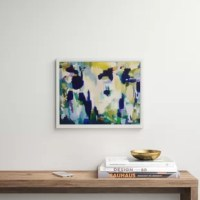 This piece of wall art brightens up a blank wall and gives your space an instant update and, TBH, we think of that as a decorating one-and-done. This abstract painting print has a design with bold streaks of blue, yellow, and green for a cool-hued vibe. It's printed in the USA on canvas, and arrives with a floater frame, so it's ready to hang right out of the box. Plus, it also includes a wall mounting hook, so you can skip a trip to the hardware store.