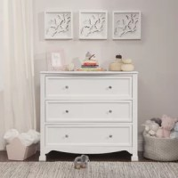 The Kalani 3 Drawer Dresser is the smart changing and storage solution for the classic Kalani, Emily and Porter collections. Three roomy drawers provide ample storage to simplify the organization while thoughtful design ensures a style fit for any nursery. The dresser is detailed with recessed front drawer panels, a gently curved apron front, and curved top sides.