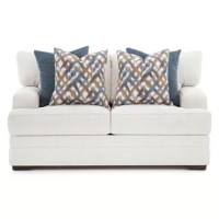 This stationery collection is upholstered in Orlando Snow, an off-white polyester fabric. The accent pillows are in Saxon Denim a dark blue shade and an interwoven line pattern in shades of blue, gold and white.