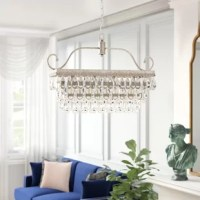 Lighting fixtures are important pieces for setting up your home's ambiance, and they're also functional. A chandelier like this, for example, is ideal for washing a room in light and glamour. Crafted from a metal frame, this 4-light tiered chandelier features a vintage-inspired silhouette for a touch of glam and carved trellis details along the canopy. Multiple tiers of glass crystals in teardrop shapes hang from the base for a grand touch of opulence. Diffusing light from four candelabra-style...