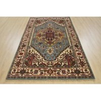 This is a Heriz rug hand-knotted in India, woven with an all wool pile on a cotton foundation. This rug is new and in excellent condition. OriginalPersian Herizdesigns revived in its traditional form.Wovenwith classic colors and patterns, these rugs capture a timeless look and feel of a style that has been around for generations. Whether a traditional or country setting these rugs would be a fine addition to any home.